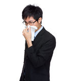Businessman with allergy sneezing Stock Photo
