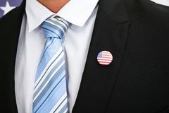 Businessman With American Badge. Close-up Of Businessman In Suit Wearing American Badge Stock Photo