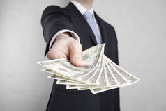Businessman with american dollars Stock Photography