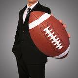 Businessman. American Football Ball Royalty Free Stock Photography