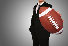 Businessman with American Football Ball Stock Image