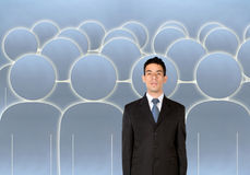 Businessman amongst a group of people Stock Images