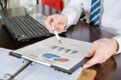 Businessman analysing economic graphs Stock Image