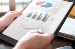 Businessman analysing economic graphs Stock Photo
