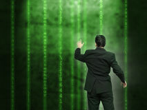 Businessman analysing source code Stock Image