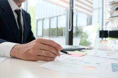 Businessman analysis finance data in paper report. Royalty Free Stock Photography