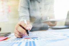 Businessman analyst data and using tablet. Startup businessman working with business documents and useing tablet Business idea concept. Selective focus at pen stock images
