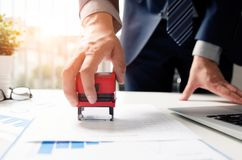 Businessman analyst working with graph, chart and stamp Stock Photos