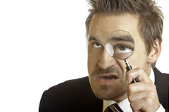 Businessman analyze problem with magnifying lens Stock Photo