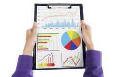 Businessman analyzes business chart Royalty Free Stock Photos