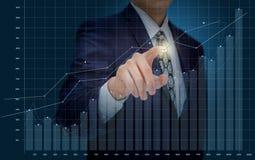 Businessman analyzes financial statistics. Stock Images