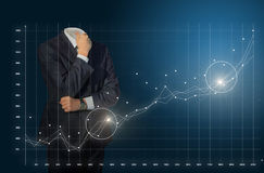 Businessman analyzes statistics chart. Stock Photos