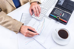 Businessman analyzing charts. Stock Photos