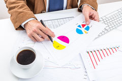 Businessman analyzing charts. Stock Images