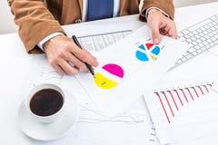 Businessman analyzing charts. Stock Images