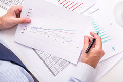 Businessman analyzing charts. Royalty Free Stock Image