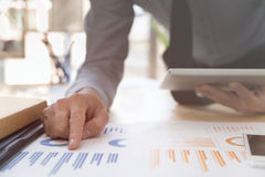 0Businessman analyzing charts and graphs with digital tablet. Royalty Free Stock Photos