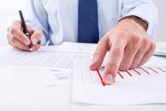 Businessman analyzing column chart. Stock Photos