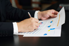 Businessman analyzing data charts at meeting room Stock Photography