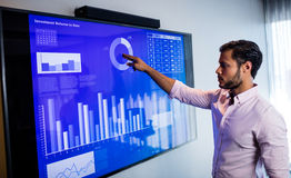 Businessman analyzing data with a touch screen Stock Photography
