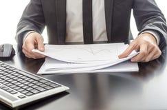 Businessman analyzing diagram Stock Image
