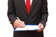 Businessman analyzing document Stock Photos
