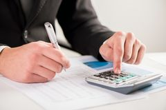 Businessman analyzing finance report Stock Photography