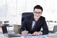Businessman analyzing financial document in office Royalty Free Stock Photography