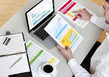 Businessman analyzing financial report Stock Photo