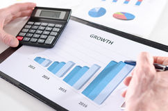 Businessman analyzing financial results Stock Photos
