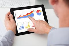 Businessman analyzing graph on digital tablet Royalty Free Stock Photos