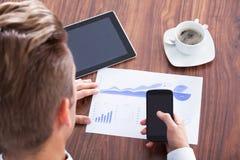 Businessman Analyzing Graph Stock Photo