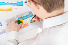 Businessman analyzing graphs Stock Photos