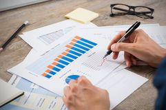 Businessman analyzing graphs stock images