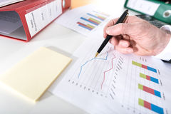 Businessman analyzing graphs Royalty Free Stock Images