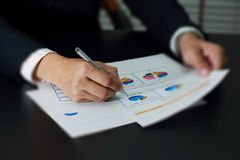 Businessman analyzing investment, budget and income charts at hi Stock Photo