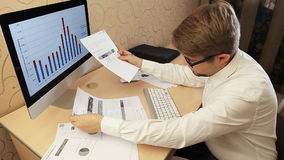 Businessman analyzing investment charts. With laptop. Accounting stock footage