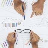 Businessman analyzing investment charts with stock market report Royalty Free Stock Photo