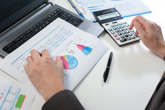 Businessman analyzing report, business performance concept Royalty Free Stock Images