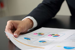 Businessman analyzing and review investment, budget and income c Royalty Free Stock Photos