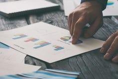 Businessman analyzing sales report Stock Photos