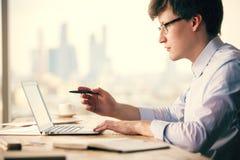 Businessman analyzing something on laptop Royalty Free Stock Photo