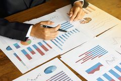 Businessman analyzing Summary report and financial . royalty free stock images