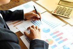 Businessman analyzing Summary report and financial . stock image