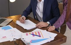 Free Businessman And Assistant Working With Documents At Table Stock Photo - 138496360