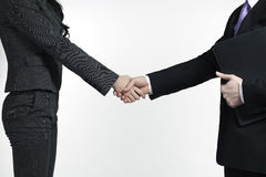 Businessman And Businesswoman Shaking Hands Stock Photography