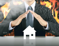 Free Businessman And Home With Fire Background Stock Images - 98489724