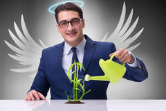 The businessman in angel investor concept growing future profits. Businessman in angel investor concept growing future profits Stock Photo