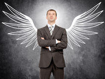 Businessman with angel wings Royalty Free Stock Images