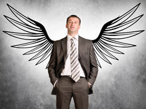 Businessman with angel wings Royalty Free Stock Photo